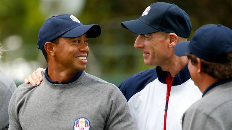 Tiger Woods with Jim Furyk