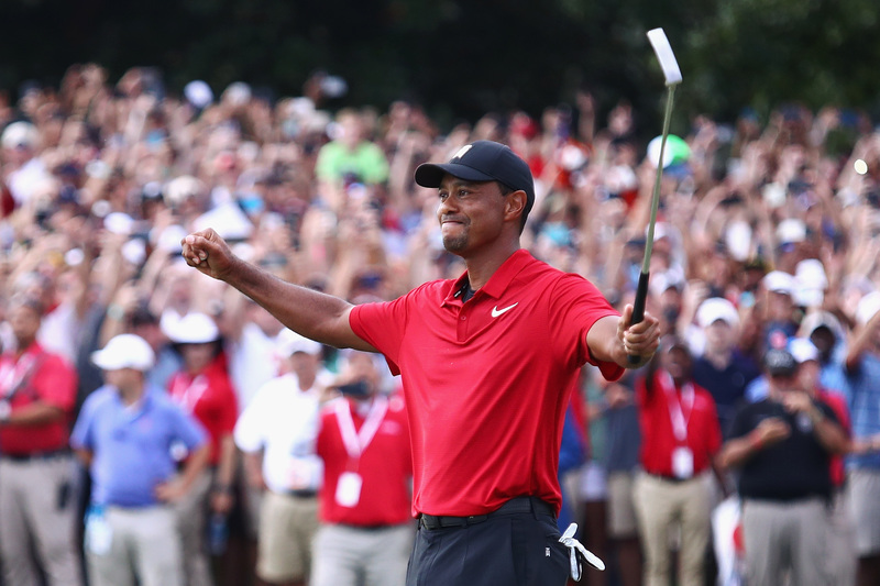 Woods historic win