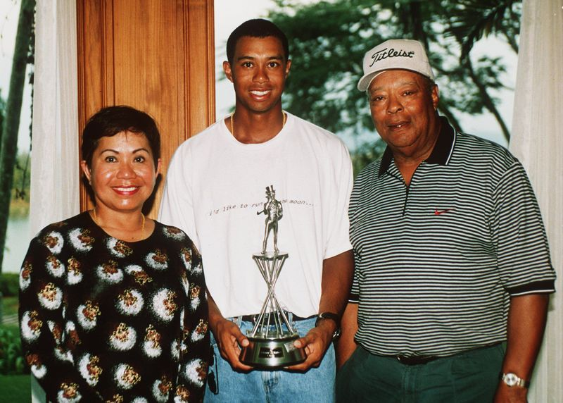 Tiger Woods with parents