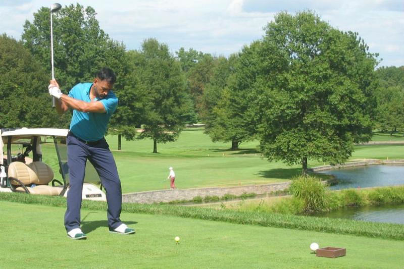 ms dhoni playing golf