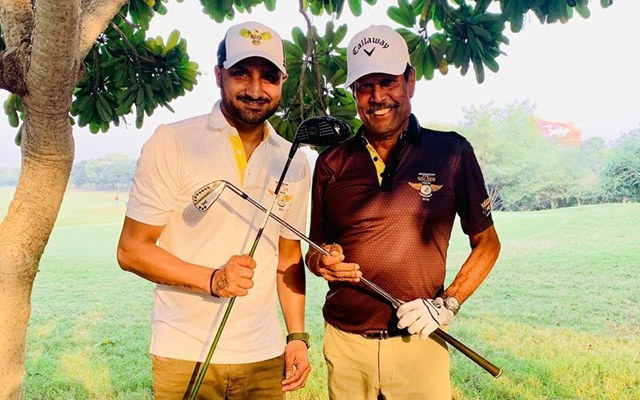 Harbhajan singh playing golf with Kapil Dev